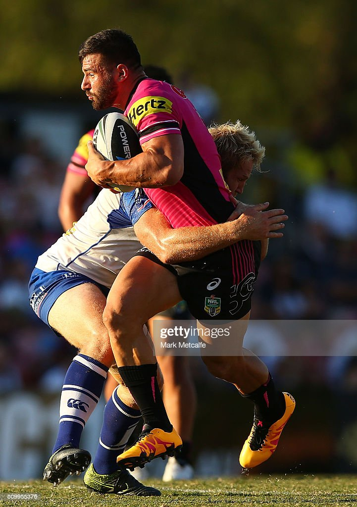 Josh Mansour of the Panthers is tackled by Aiden Tolman of the Bulldogs during the NRL Trial match between the Canterbury Bulldogs and the Penrith Panthers at Pepper Stadium on February 13, 2016 in Sydney, Australia.