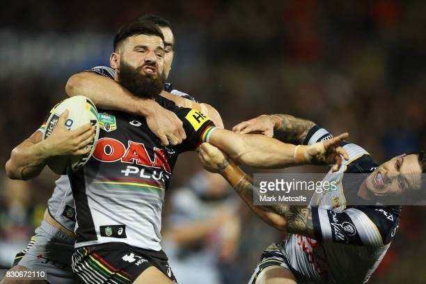 Josh Mansour of the Panthers is tackled by Kane Linnett of the Cowboys during the round 23 NRL match between the Penrith Panthers and the North...