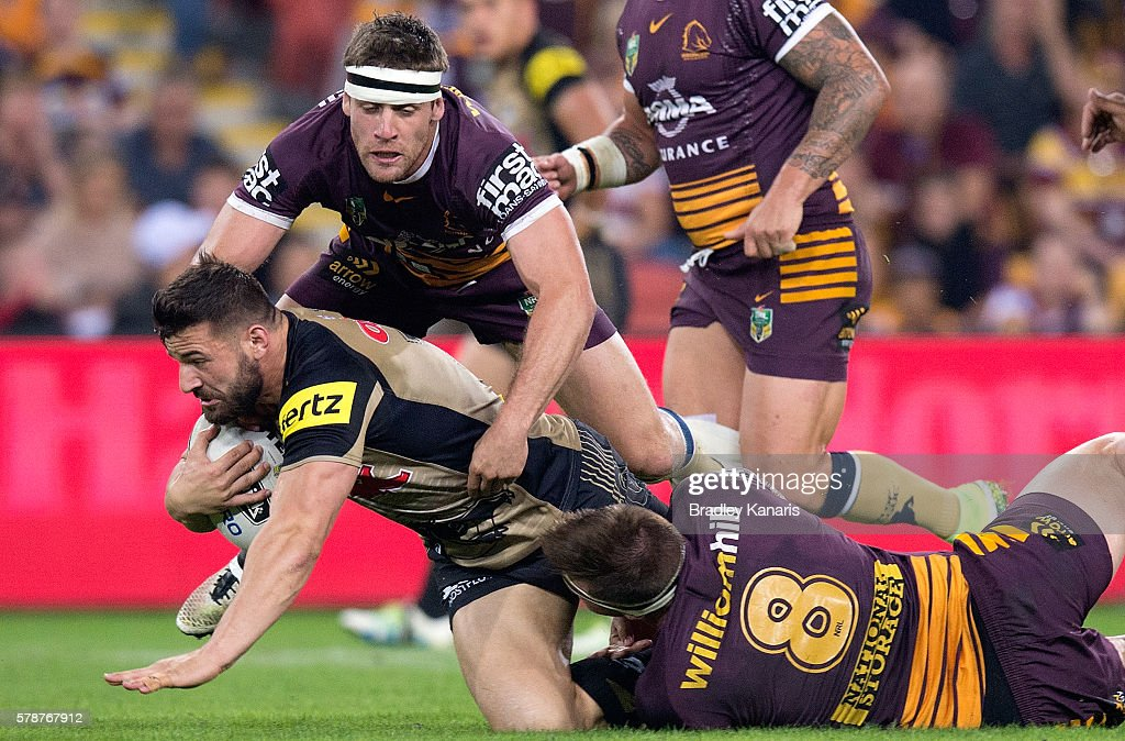 Josh Mansour of the Panthers is tackled during the round 20 NRL match between the Brisbane Broncos and the Penrith Panthers at Suncorp Stadium on July 22, 2016 in Brisbane, Australia.