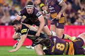 Josh Mansour of the Panthers is tackled during the round 20 NRL match between the Brisbane Broncos and the Penrith Panthers at Suncorp Stadium on...