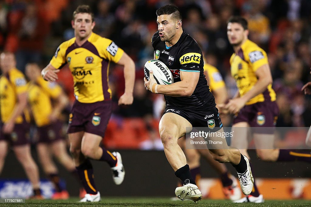 Josh Mansour of the Panthers runs with the ball during the round 24 NRL match between the Penrith Panthers and the Brisbane Broncos at Centrebet Stadium on August 23, 2013 in Sydney, Australia.