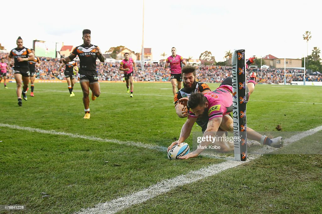 Josh Mansour of the Panthers scores a try during the round 16 NRL match between the Wests Tigers and the Penrith Panthers at Leichhardt Oval on June 28, 2015 in Sydney, Australia.