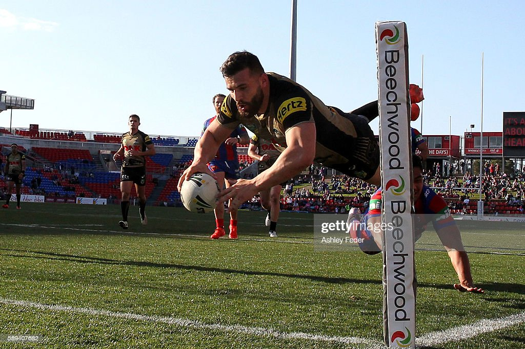 Josh Mansour of the Panthers scores a try during the round 23 NRL match between the Newcastle Knights and the Penrith Panthers at Hunter Stadium on August 14, 2016 in Newcastle, Australia.