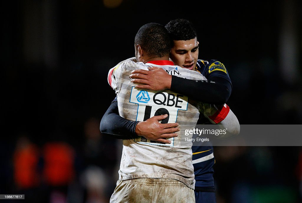 Josh Matavesi of Worcester hugs Kameli Ratuvou of Saracens following the Aviva Premiership match between Worcester Warriors and Saracens at Sixways Stadium on November 23, 2012 in Worcester, England.