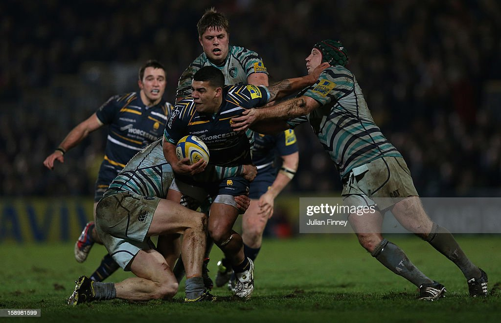 Josh Matavesi of Worcester is tackled by <a gi-track='captionPersonalityLinkClicked' href=/galleries/search?phrase=Thomas+Waldrom&family=editorial&specificpeople=561813 ng-click='$event.stopPropagation()'>Thomas Waldrom</a> Leicester Tigers (R) during the Aviva Premiership match between Worcester Warriors and Leicester Tigers at Sixways Stadium on January 4, 2013 in Worcester, England.