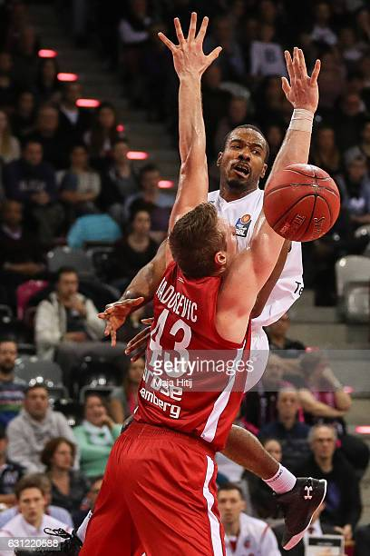 Josh Mayo of Telekom Baskets Bonn is challenged by Leon Radosevic of Brose Bamberg during the BBL Bundesliga match between Telekom Baskets Bonn and...
