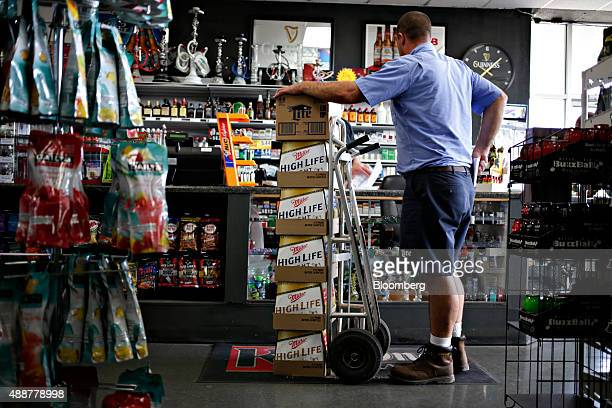 Josh McCartney a driver with Baumgarten Distributing Co stands at the counter of a liquor store while making a beer delivery in Chillicothe Illinois...
