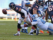 Josh McCown of the Chicago Bears is sacked by Nick Fairley of the Detroit Lions at Soldier Field on November 10 2013 in Chicago Illinois The Lions...