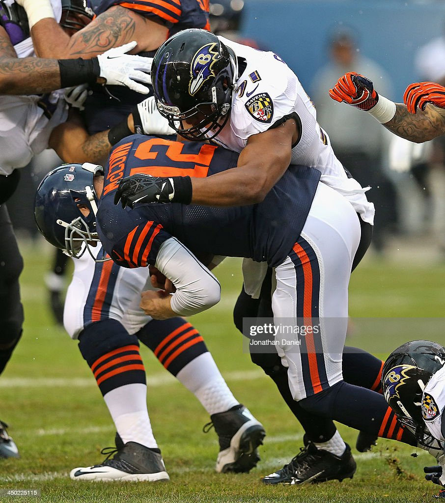 Josh McCown #12 of the Chicago Bears is tackled by Daryl Smith #51 of the Baltimore Ravens at Soldier Field on November 17, 2013 in Chicago, Illinois.