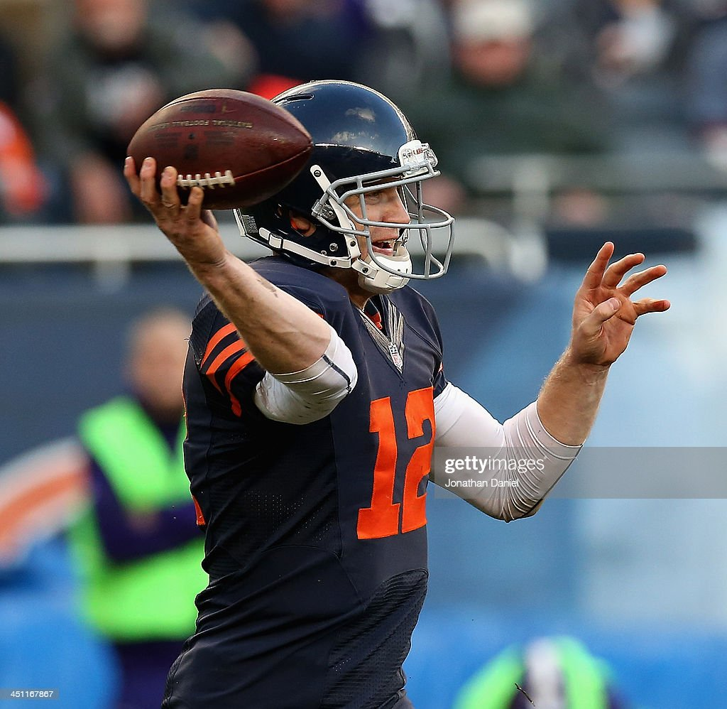 Josh McCown #12 of the Chicago Bears passes against the Baltimore Ravens at Soldier Field on November 17, 2013 in Chicago, Illinois. The Bears defeated the Ravens 23-20 in overtime.