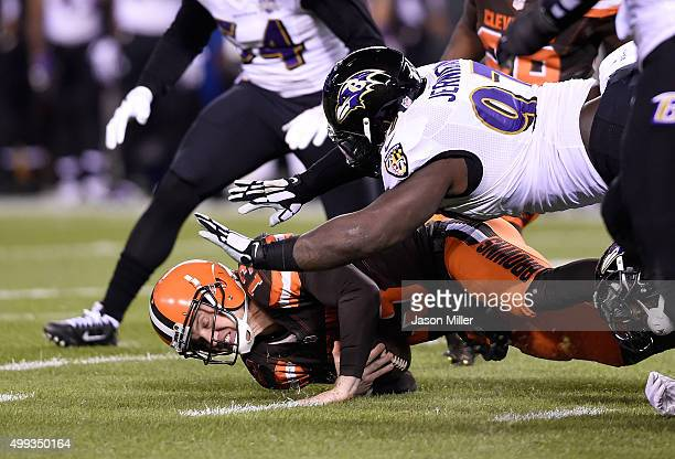 Josh McCown of the Cleveland Browns gets tackled by Timmy Jernigan of the Baltimore Ravens during the first quarter at FirstEnergy Stadium on...