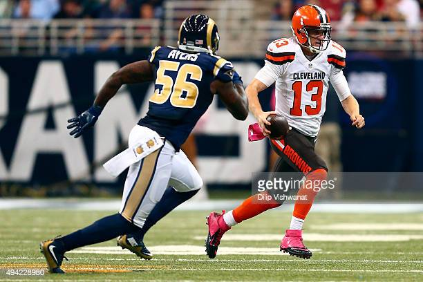 Josh McCown of the Cleveland Browns scrambles while under pressure from Akeem Ayers of the St Louis Rams in the second quarter at the Edward Jones...