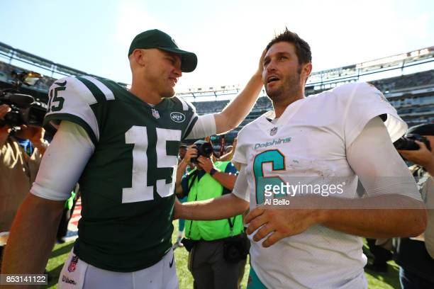 Josh McCown of the New York Jets and Jay Cutler of the Miami Dolphins meet after the Jets 206 win after their game at MetLife Stadium on September 24...