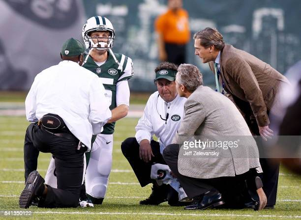Josh McCown of the New York Jets gets attention from medical personnel after being sacked against the Philadelphia Eagles during their preseason game...
