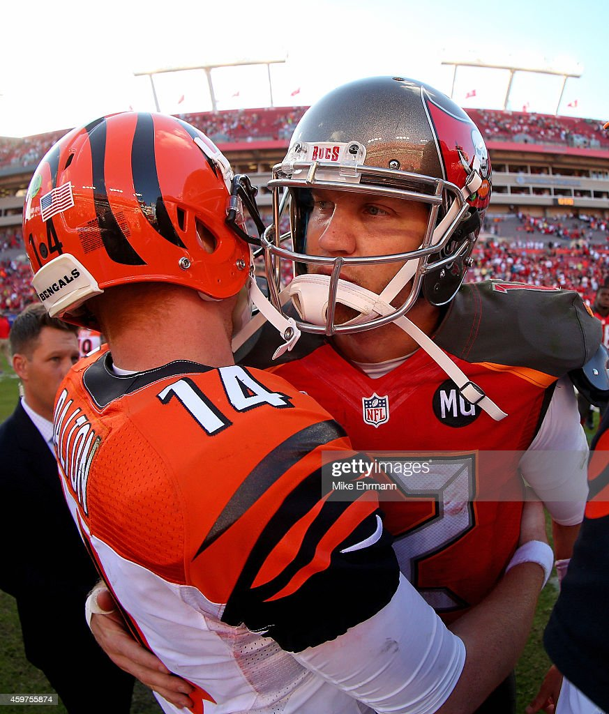 Josh McCown of the Tampa Bay Buccaneers and Andy Dalton of the Cincinnati Bengals shake hands after a game at Raymond James Stadium on November 30...