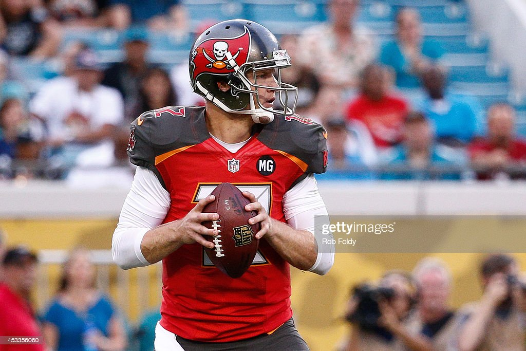 Josh McCown #12 of the Tampa Bay Buccaneers drops back to pass during the first quarter of the preseason game against the Jacksonville Jaguars at Everbank Field on August 8, 2014 in Jacksonville, Florida.