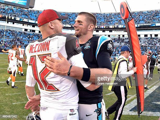 Josh McCown of the Tampa Bay Buccaneers talks with Derek Anderson of the Carolina Panthers following their game at Bank of America Stadium on...