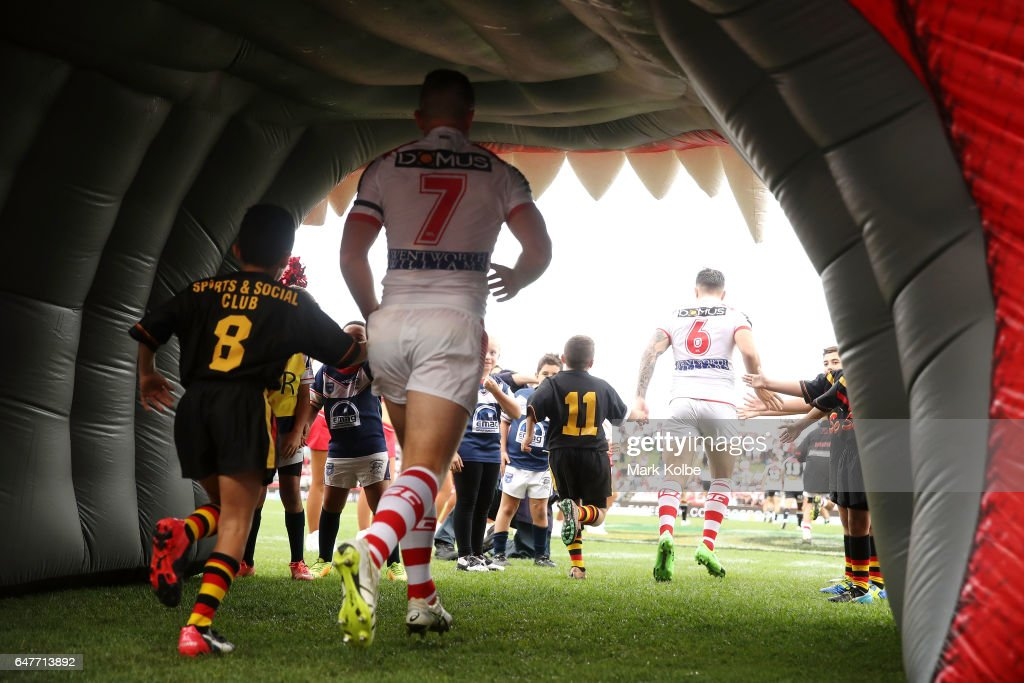 Josh McCrone and Gareth Widdop of the Dragons run out during the round one NRL match between the St George Illawarra Dragons and the Penrith Panthers at UOW Jubilee Oval on March 4, 2017 in Sydney, Australia.