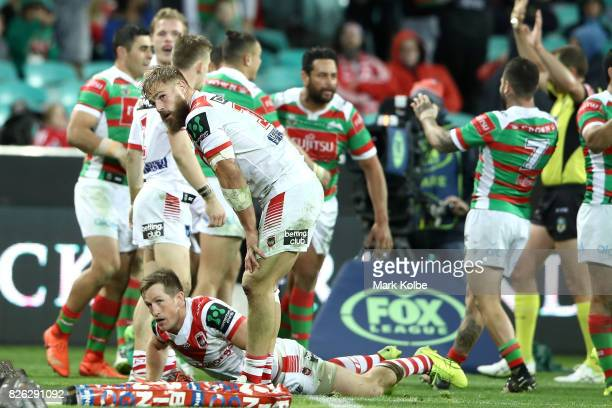 Josh McCrone and Jack de Belin of the Dragons looks dejected after Bryson Goodwin of the Rabbitohs scored a try late in the match to level the scores...