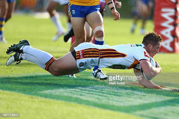 Josh McCrone of Country scores a try during the Origin match between City and Country at BCU International Stadium on April 21 2013 in Coffs Harbour...
