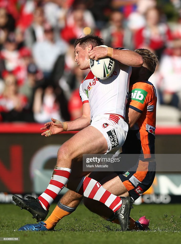 Josh McCrone of the Dragons is tackled during the round 16 NRL match between the St George Illawarra Dragons and the Newcastle Knights at UOW Jubilee Oval on June 25, 2017 in Sydney, Australia.