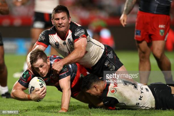 Josh McCrone of the Dragons is tackled short of the line during the round four NRL match between the St George Illawarra Dragons and the New Zealand...