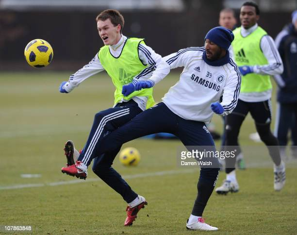 Josh McEachran Nicolas Anelka of Chelsea during a training session at the Cobham training ground on January 4 2011 in Cobham England