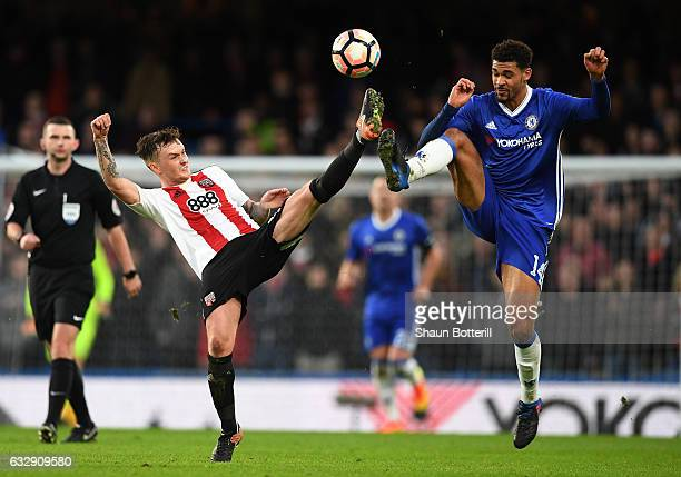 Josh McEachran of Brentford and Ruben LoftusCheek of Chelsea compete for the ball during the Emirates FA Cup Fourth Round match between Chelsea and...