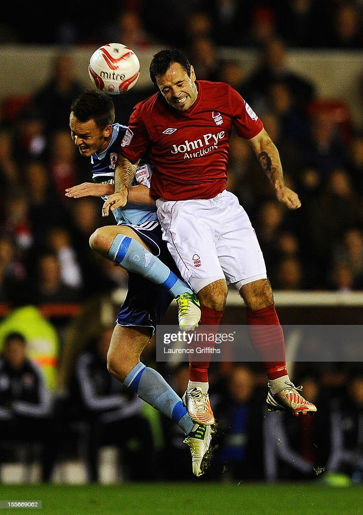 <a gi-track='captionPersonalityLinkClicked' href=/galleries/search?phrase=Josh+McEachran&family=editorial&specificpeople=6871629 ng-click='$event.stopPropagation()'>Josh McEachran</a> of Middlesbrough battles with Andy Reid of Nottingham Forest during the npower Championship match between Nottingham Forest and Middlesbrough at the City Ground on November 6, 2012 in Nottingham, England.