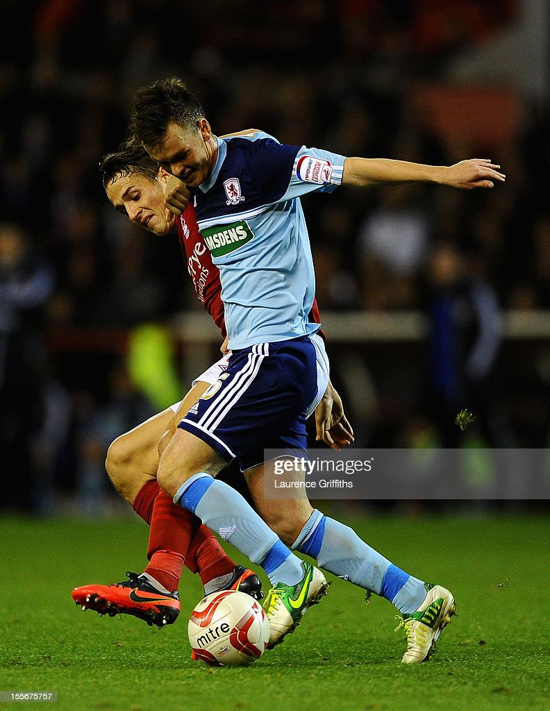 <a gi-track='captionPersonalityLinkClicked' href=/galleries/search?phrase=Josh+McEachran&family=editorial&specificpeople=6871629 ng-click='$event.stopPropagation()'>Josh McEachran</a> of Middlesbrough battles with Chris Cohen of Nottingham Forest during the npower Championship match between Nottingham Forest and Middlesbrough at the City Ground on November 6, 2012 in Nottingham, England.