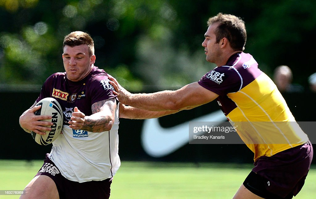 Josh McGuire attempts to break away from the defence during a Brisbane Broncos NRL training session on March 7, 2013 in Brisbane, Australia.