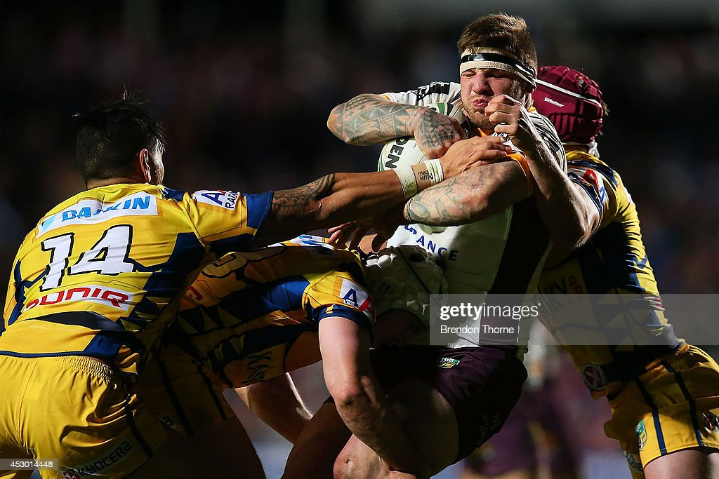 Josh McGuire of the Broncos is tackled by the Sea Eagles defence during the round 21 NRL match between the Manly-Warringah Sea Eagles and the Brisbane Broncos at Brookvale Oval on August 1, 2014 in Sydney, Australia.