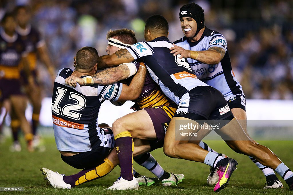 Josh McGuire of the Broncos is tackled during the round nine NRL match between the Cronulla Sharks and the Brisbane Broncos at Southern Cross Group Stadium on May 1, 2016 in Sydney, Australia.