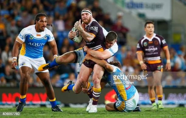 Josh McGuire of the Broncos runs with the ball during the round 22 NRL match between the Gold Coast Titans and the Brisbane Broncos at Cbus Super...