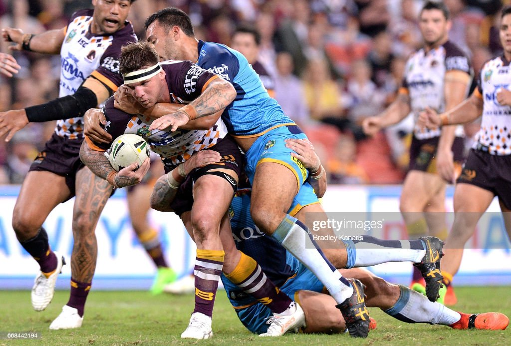 Josh McGuire of the Broncos takes on the defence during the round seven NRL match between the Brisbane Broncos and the Gold Coast Titans at Suncorp Stadium on April 14, 2017 in Brisbane, Australia.