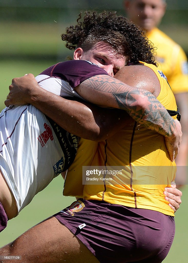 Josh McGuire tackles team mate Sam Thaiday during a Brisbane Broncos NRL training session on March 7, 2013 in Brisbane, Australia.