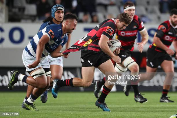 Josh McKay of Canterbury is tackled by Samuel Slade of Auckland during the round nine Mitre 10 Cup match between Auckland and Canterbury at Eden Park...