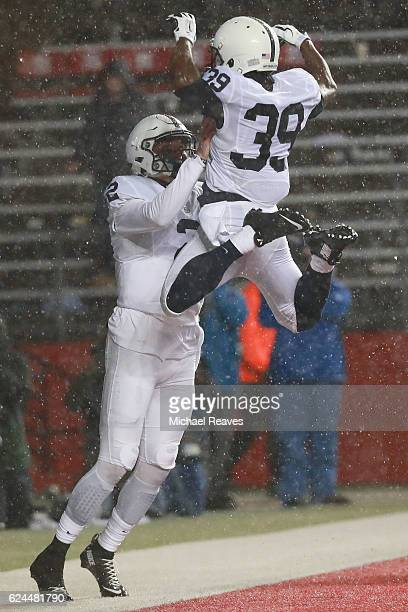 Josh McPhearson of the Penn State Nittany Lions celebrates with Tommy Stevens of the Penn State Nittany Lions after he scored a touchdown against the...