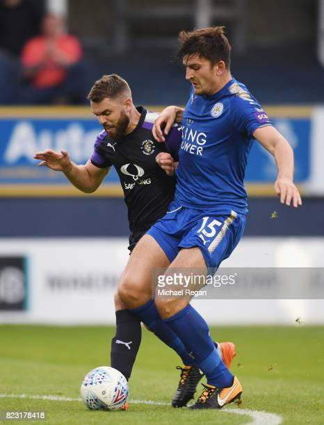 Josh McQuoid of Luton in action with Harry Maguire of Leicester during the preseason friendly match between Luton Town and Leicester City at...