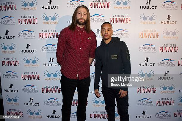 Josh McRoberts and Shabazz Napier attends 'A Night On The Runwade' fundrasing event at Ice Palace Film Studios on November 18 2014 in Miami Florida