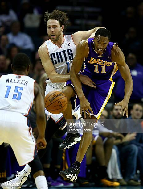 Josh McRoberts of the Charlotte Bobcats and Wesley Johnson of the Los Angeles Lakers go after a loose ball during their game at Time Warner Cable...