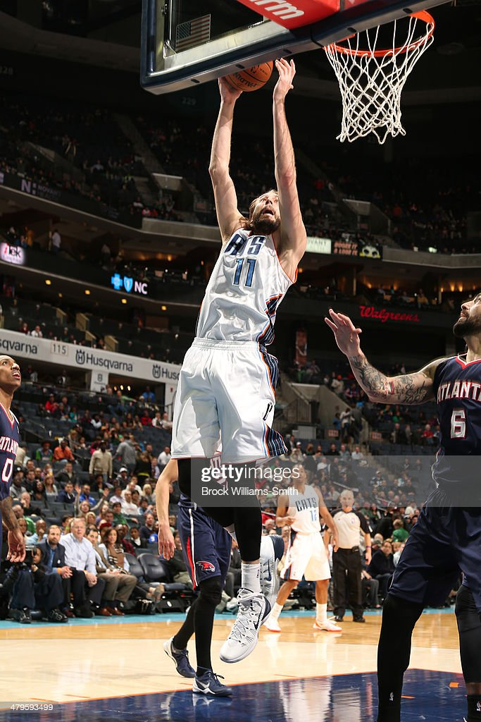Josh McRoberts #11 of the Charlotte Bobcats attempts to lay the ball in the basket against the Atlanta Hawks during the game at the Time Warner Cable Arena on March 17, 2014 in Charlotte, North Carolina.