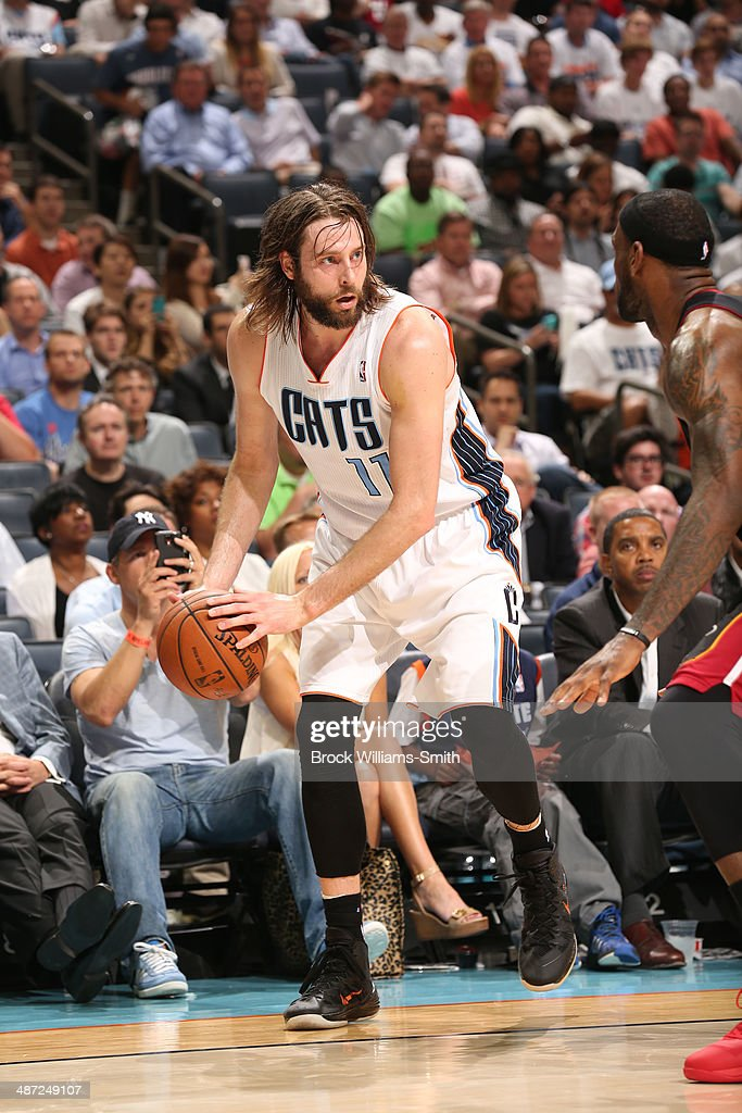 Josh McRoberts #11 of the Charlotte Bobcats controls the ball against the Miami Heat in Game Four of the Eastern Conference Quarterfinals in the 2014 NBA Playoffs at the Time Warner Cable Arena on April 28, 2014 in Charlotte, North Carolina.