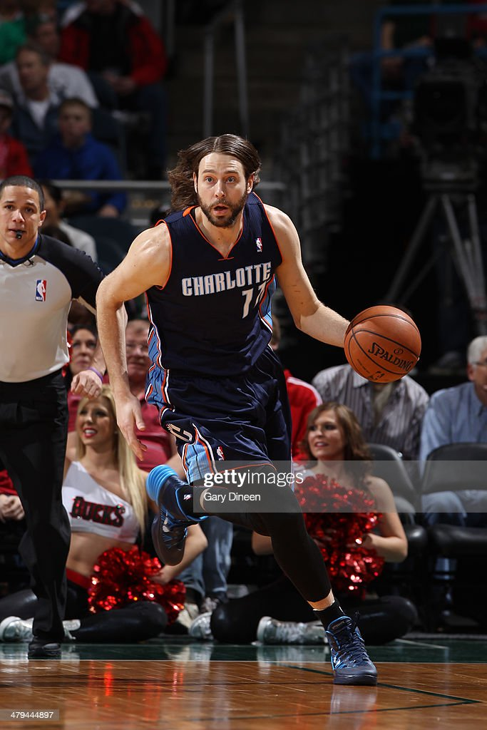 <a gi-track='captionPersonalityLinkClicked' href=/galleries/search?phrase=Josh+McRoberts&family=editorial&specificpeople=732530 ng-click='$event.stopPropagation()'>Josh McRoberts</a> #11 of the Charlotte Bobcats dribbles the ball against the Milwaukee Bucks on March 16, 2014 at the BMO Harris Bradley Center in Milwaukee, Wisconsin.