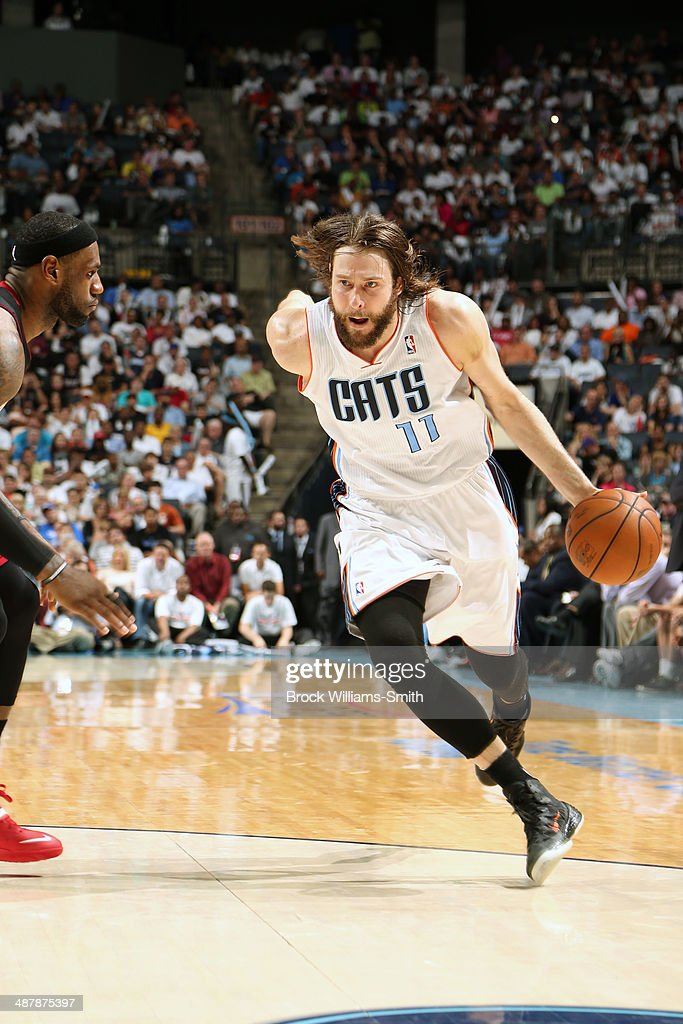 <a gi-track='captionPersonalityLinkClicked' href=/galleries/search?phrase=Josh+McRoberts&family=editorial&specificpeople=732530 ng-click='$event.stopPropagation()'>Josh McRoberts</a> #11 of the Charlotte Bobcats drives against the Miami Heat in Game One of the Eastern Conference Quarterfinals of the 2014 NBA playoffs at the Time Warner Cable Arena on April 28, 2014 in Charlotte, North Carolina.