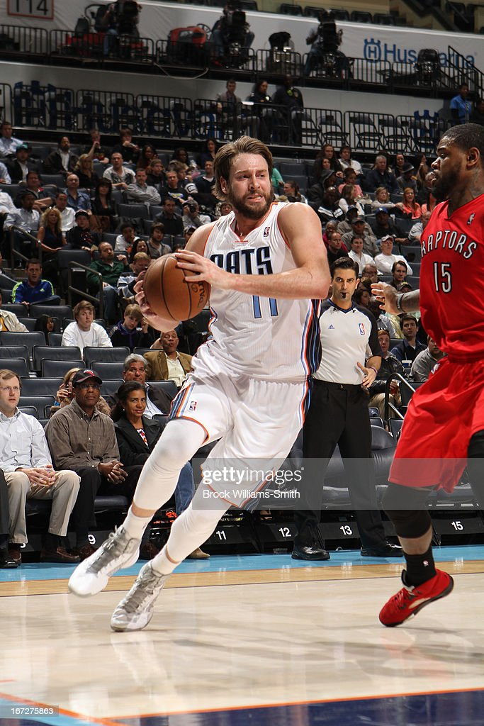 Josh McRoberts #11 of the Charlotte Bobcats drives to the basket against the Toronto Raptors at the Time Warner Cable Arena on March 20, 2013 in Charlotte, North Carolina.
