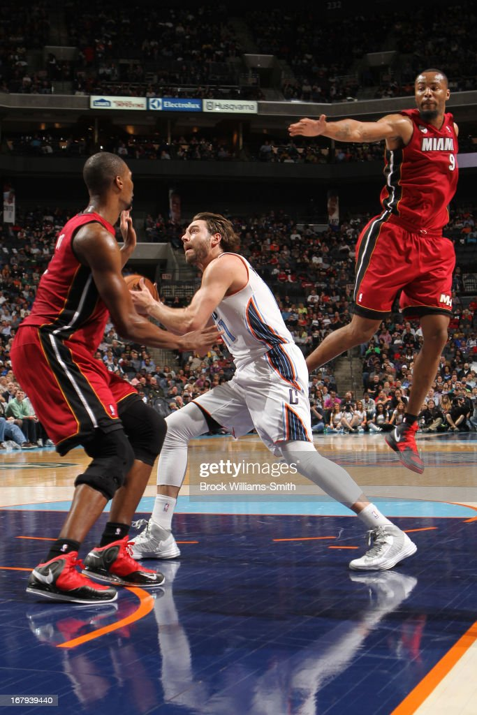 Josh McRoberts #11 of the Charlotte Bobcats drives to the basket against the Miami Heat at the Time Warner Cable Arena on April 5, 2013 in Charlotte, North Carolina.