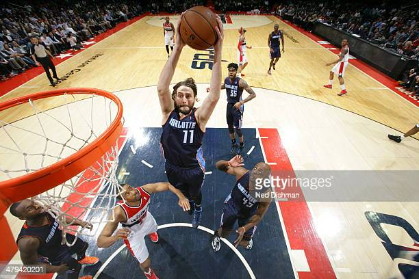 Josh McRoberts of the Charlotte Bobcats goes up for a dunk against the Washington Wizards at the Verizon Center on March 12 2014 in Washington DC...