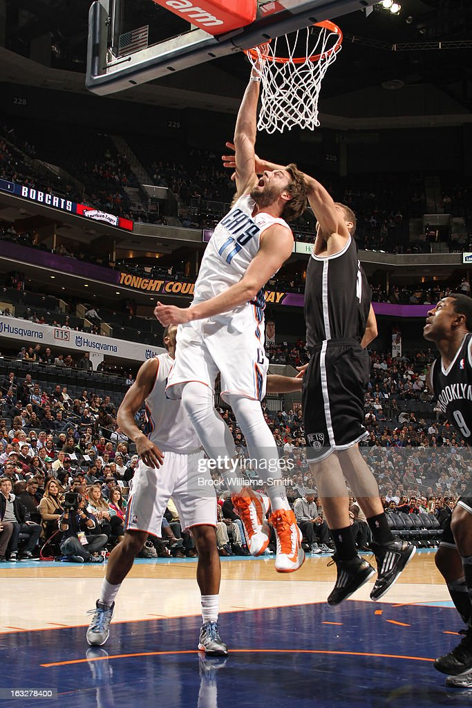 Josh McRoberts #11 of the Charlotte Bobcats goes up for a rebound against Brook Lopez #11 of the Brooklyn Nets at the Time Warner Cable Arena on March 6, 2013 in Charlotte, North Carolina.