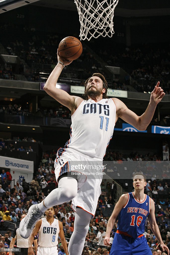 <a gi-track='captionPersonalityLinkClicked' href=/galleries/search?phrase=Josh+McRoberts&family=editorial&specificpeople=732530 ng-click='$event.stopPropagation()'>Josh McRoberts</a> #11 of the Charlotte Bobcats goes up for the dunk against the New York Knicks at the Time Warner Cable Arena on April 15, 2013 in Charlotte, North Carolina.